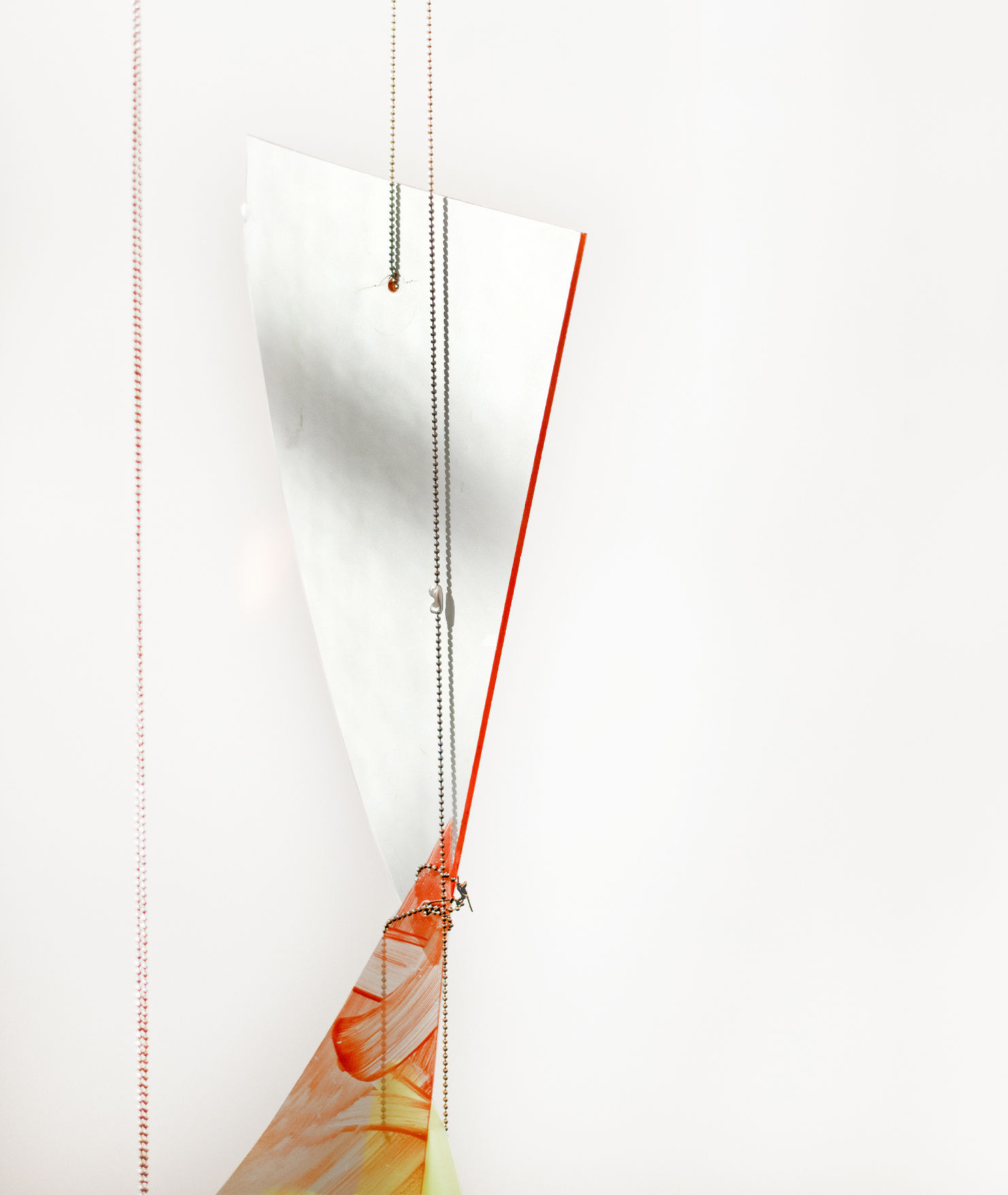 Mobile sculpture with plastic and small metal chain.