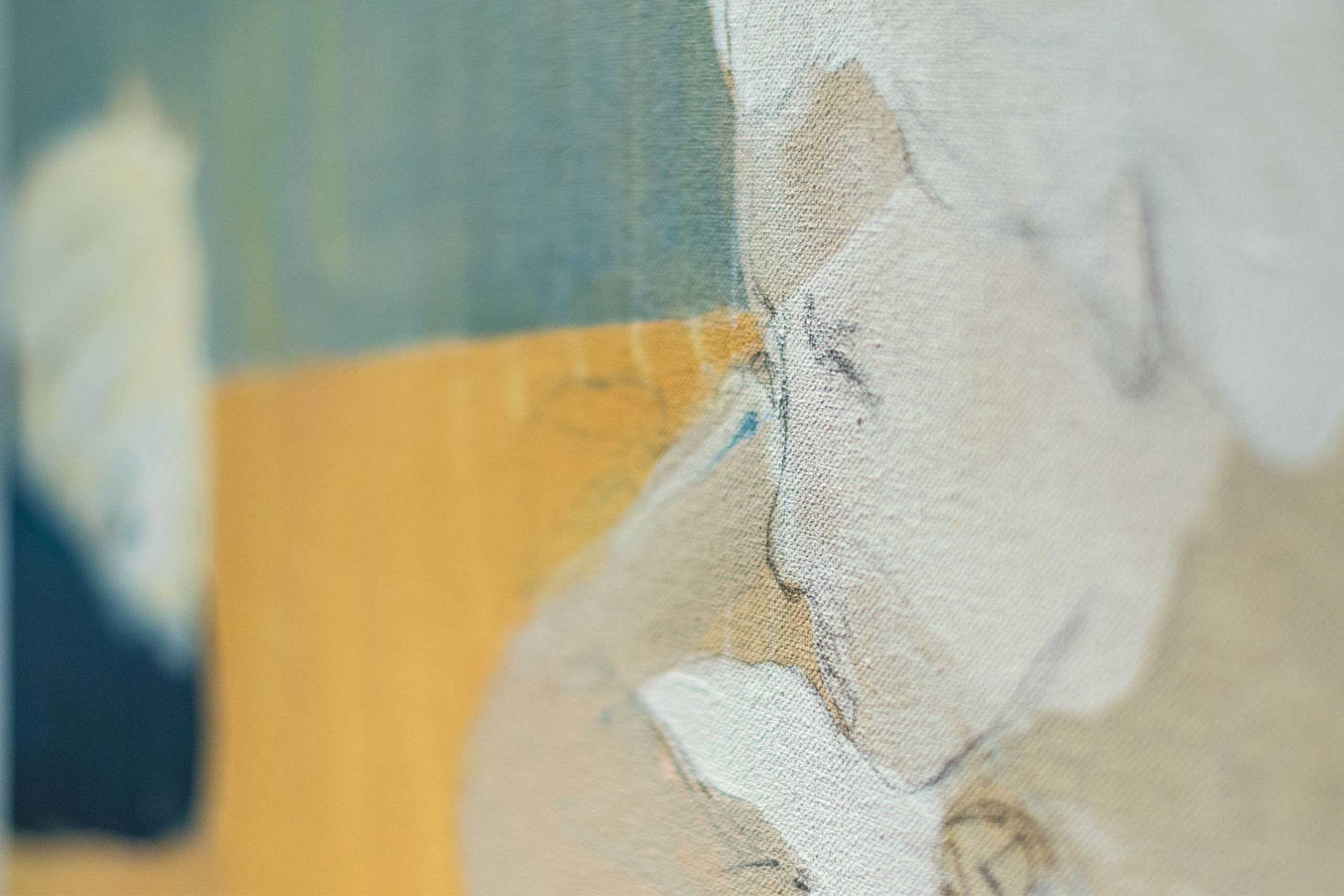 Close-up of painting showing tan, yellow and teal tones.