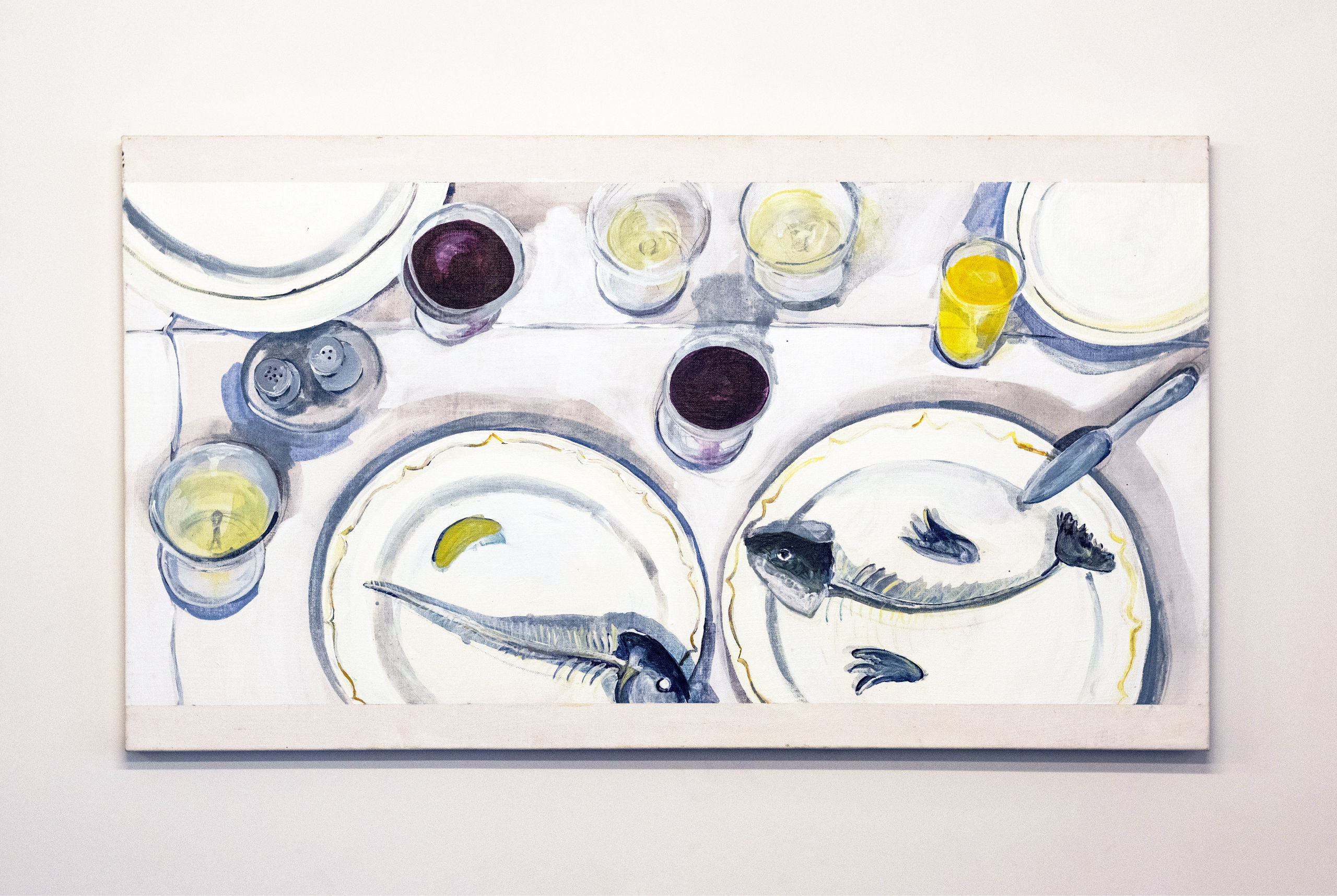 Two plates with fish bones and glasses on table, painting.