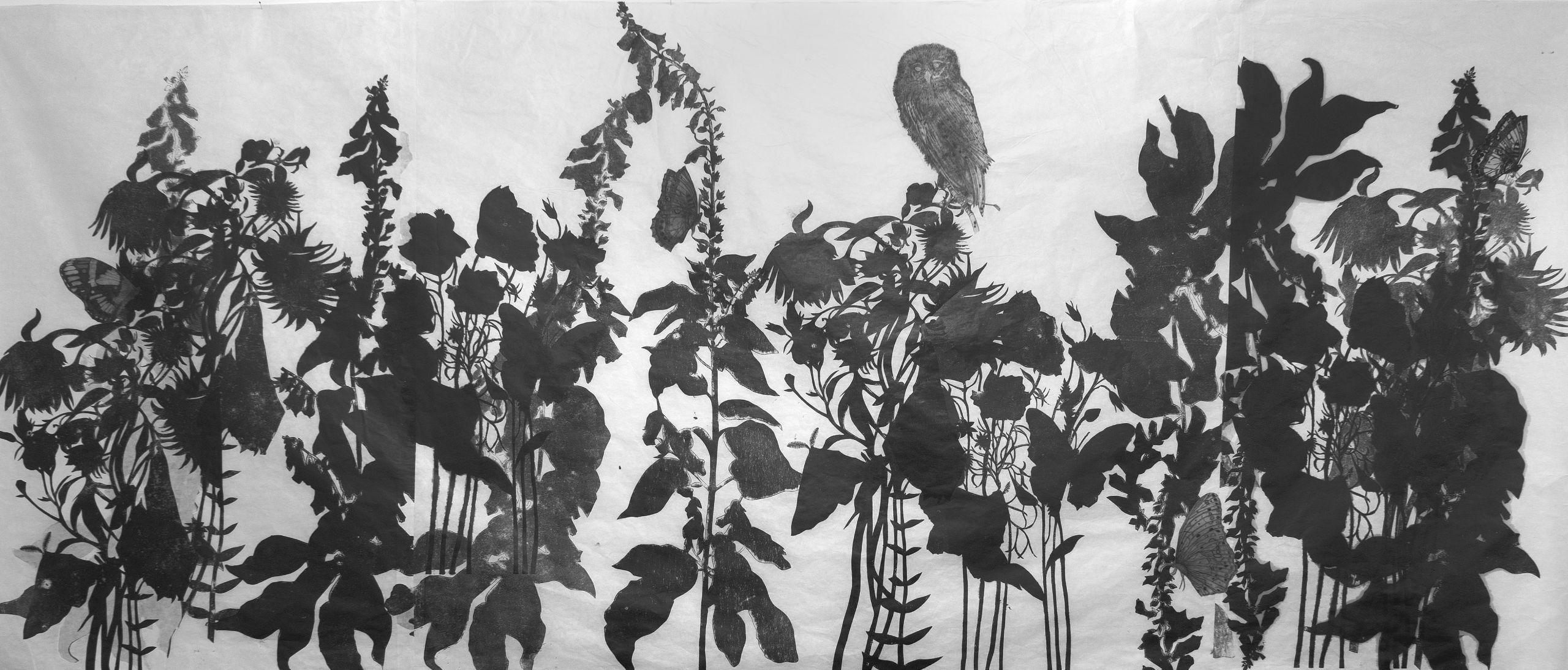 Black and white print of foliage.