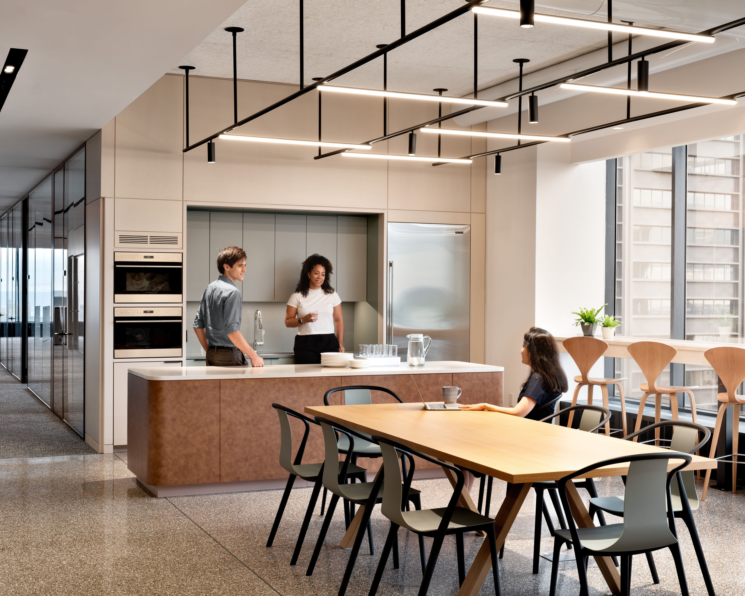 Wallace Foundation kitchen with two people at counter and one person at table